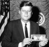 JFK Holding a Savings Bond